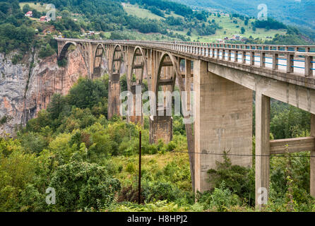Durdevica Tara Bridge, concrete arch bridge over Tara River Canyon, Durmitor National Park, Dinaric Alps, Montenegro - Stock Photo