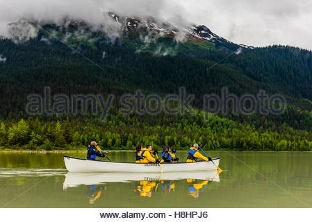Canoeing on Mendenhall Lake on a glacier paddle & trek trip with Above & Beyond Alaska to hike on Mendenhall Glacier, - Stock Photo