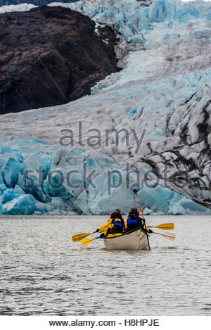 Canoeing on Mendenhall Lake with Mendenhall Glacier in background, Juneau, Alaska USA. - Stock Photo