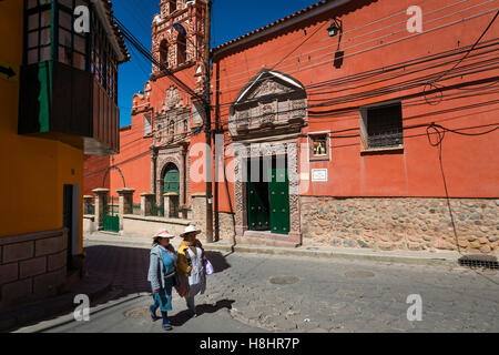 Potosi, Bolivia - November 29, 2013: Two women wearing traditional clothes in the city of Potosi in Bolivia. - Stock Photo
