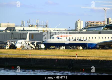 LONDON, UK - SEPTEMBER 11, 2016: An Embraer ERJ-190SR by British Airways CityFlyer (G-LCYO) taxiing at LCY - Stock Photo