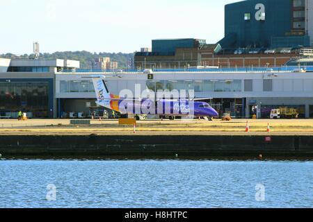 LONDON, UK - SEPTEMBER 11, 2016: A Bombardier Dash 8 Q400 by Flybe (G-JEDU) on the airfield at LCY - Stock Photo