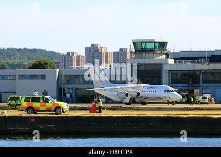 LONDON, UK - SEPTEMBER 11, 2016: An Avro RJ85 by CityJet on the airfield at LCY - Stock Photo