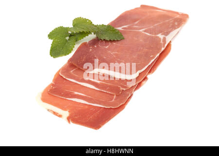 closeup on a piece of spanish serrano ham, isolated on white - Stock Photo