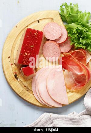 Assorted deli meats - ham, salami, parma, prosciutto, pate - Stock Photo