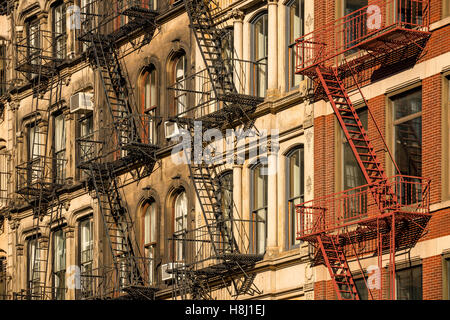 Soho building facades with fire escapes, Manhattan, New York City - Stock Photo