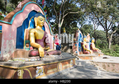 Nepal, Kathmandu, Swayambunath Stupa (Monkey Temple) Bhudda image at base of stupa - Stock Photo
