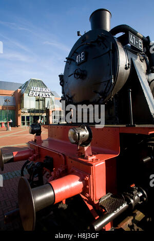 Germany,  Ruhr Area, Bochum, the Starlight Express musical theatre, old railway locomotive in front of the building. - Stock Photo