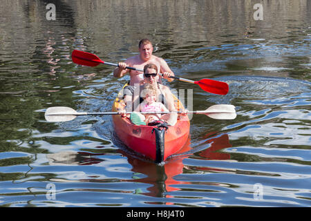 Family in Kayak  at river Ourthe near La Roche-en-Ardenne, Belgium - Stock Photo