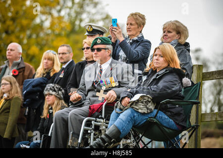 Veterans, service personnel and families look on during the first ever memorial service dedicated to horses killed - Stock Photo