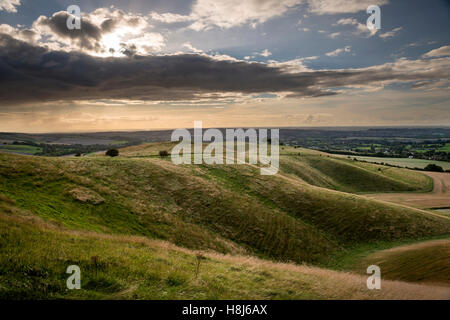 Oldbury Long Barrow viewed from Oldbury Iron Age hill fort on Cherhill Down, Wiltshire, UK - Stock Photo