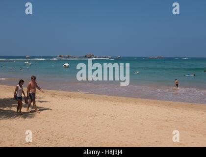 Tourists on a beach in Sri Lanka - Stock Photo