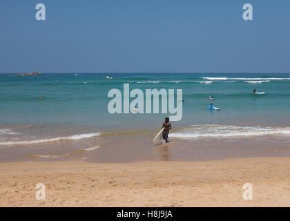 Tourists on a beach in Sri Lanka. - Stock Photo
