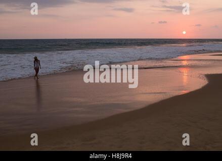 Sunset on Hikkaduwa beach, Sri Lanka. - Stock Photo