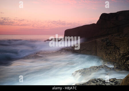 Water flowing against the shore - sunset at Ile Grande, Brittany - Stock Photo