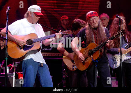 Willie Nelson performing with Neil Young live during Farm Aid 2007 at Randall's Island in New York City on September - Stock Photo