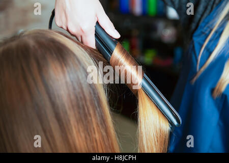 Woman hairdresser making hairstyle. - Stock Photo