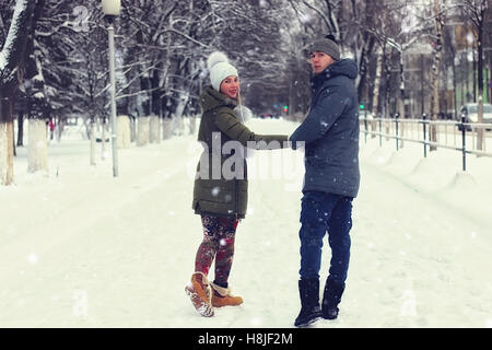 young couple walking winter - Stock Photo