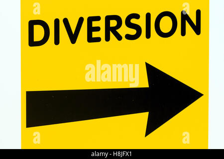Yellow diversion sign board with black Right pointing arrow - Stock Photo
