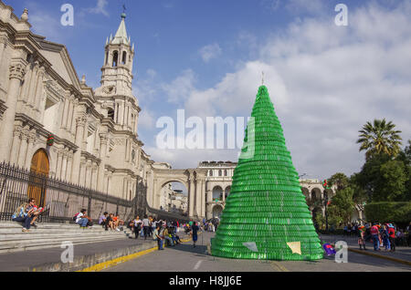 Arequipa, Peru - January 2, 2014: Christmas tree on Plaza de Armas square with Basilica Cathedral of Arequipa - Stock Photo