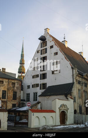 Riga, Latvia - March 8, 2011: Traditional medieval houses in street of Riga old town. - Stock Photo