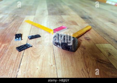 instrumets for installing laminate floor - Stock Photo