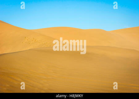 Colorful sand dunes in Gobi desert, Dunhuang, China - Stock Photo