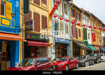 Shophouses and small stalls in Chinatown, Singapore - Stock Photo