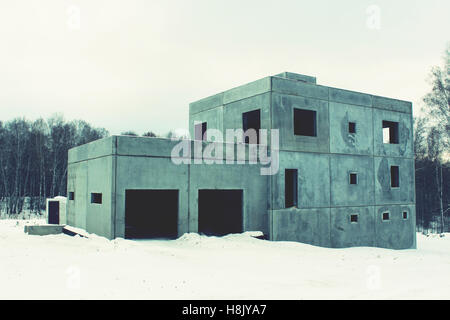 Old unfinished abandoned house in the village - Stock Photo