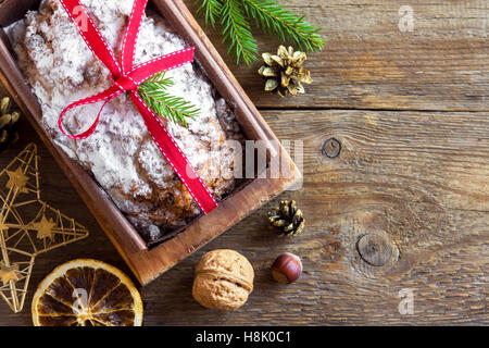 Traditional fruitcake for Christmas with decoration and ornaments - homemade Christmas pasrty - Stock Photo