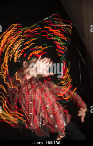 Teen in Swirling Lights - Stock Photo