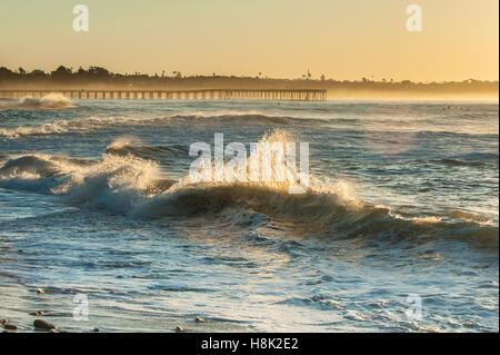 Ventura beach at dawn under glowing sky - Stock Photo