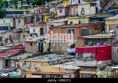 Colorful houses of the poor inhabitants of Luanda, Angola. These ghettos resemble Brasilian favelas. - Stock Photo