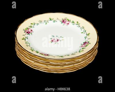 Set of 1920's Tuscan China (RH & SL PLant Ltd, Longton, Staffordshire) gilt edged porcelain dinner plates - Stock Photo