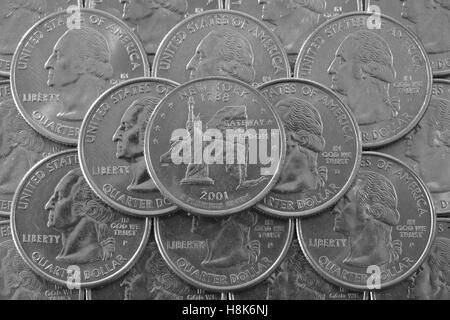 Coins of USA. Pile of the US quarter coins with George Washington and on the top a quarter of New York State. - Stock Photo