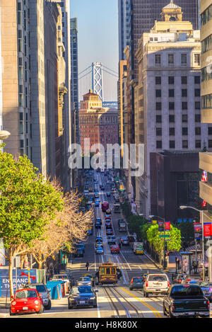 SAN FRANCISCO, USA - DECEMBER 16: Passengers enjoy a ride in a cable car on Dec 16, 2013 in San Francisco. It is - Stock Photo