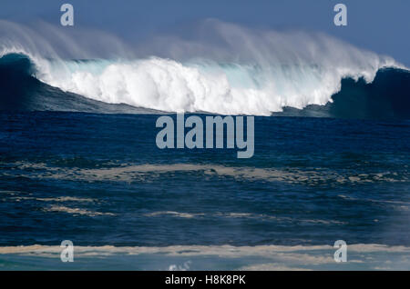 A giant beautiful breaking ocean wave on the north shore of Oahu Hawaii - Stock Photo