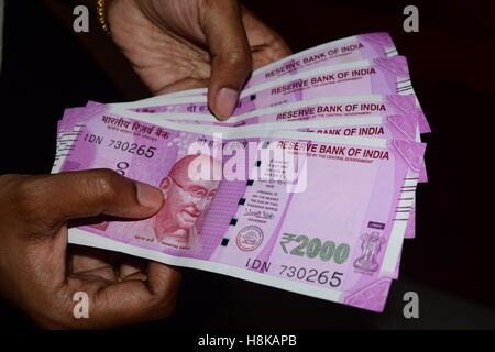 Counting the New 2000 Rupees Indian currency Banknotes - Stock Photo
