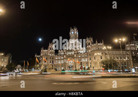 The largest moon in the last 70 years captured over one of the main touristic sports of Madrid, the Square of Cibeles. - Stock Photo