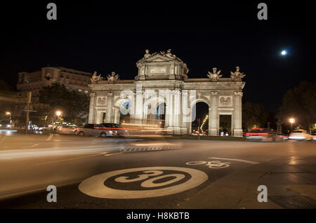 The largest moon in the last 70 years captured over one of the main touristic sports of Madrid, the Alcalá Gate. - Stock Photo