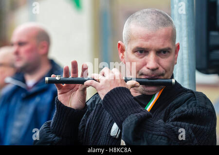 Belfast, Northern, Ireland. 13th Nov, 2016. A man plays a lament on a flute as Republicans hold a parade in remembrance - Stock Photo
