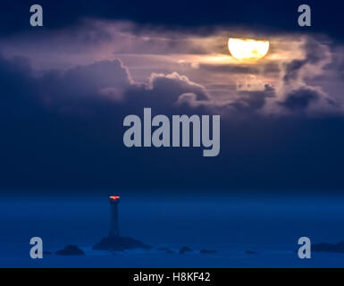 Lands End, Cornwall, UK. 14th Nov, 2016. UK Weather. The Supermoon sets over the Longships lighthouse at Lands End, - Stock Photo