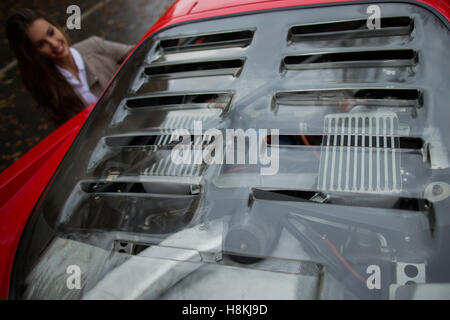 Essen, Germany. 8th Nov, 2016. Vivien standing next to a Ferrari F40 during a photo call for the Essen Motor Show - Stock Photo