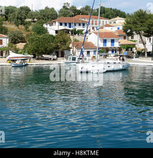 Vathi, GREECE, May 11, 2013: Landscape with mooring and yacht in port on the Meganisi island. Ionian sea, Greece. - Stock Photo