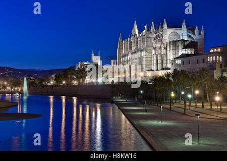 Palma Cathedral at night with the Almudaina Palace  Parc de La Mar Palma de Mallorca Balearic Islands Spain - Stock Photo