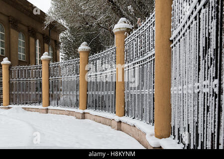 The old fence of metal bars and round pillars - Stock Photo