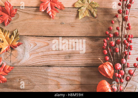 Image of top view mockup scene with wooden background and autumn plants. - Stock Photo
