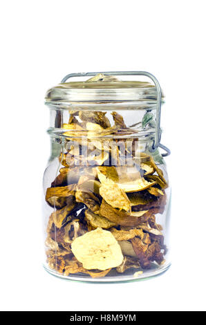 Glass jar full dry boletus edulis mushrooms isolated on white - Stock Photo