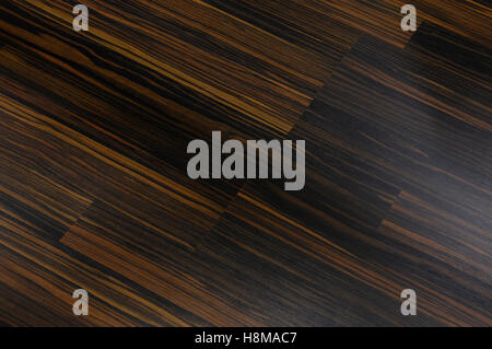 Dark brown wood laminated floor, background - Stock Photo