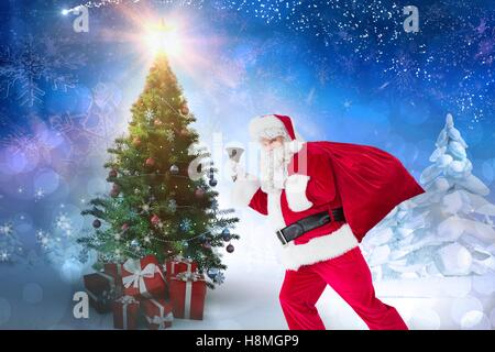 Woman in santa costume holding gifts against christmas background - Stock Photo